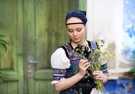 Beautiful woman wearing traditional Eastern Europe folk costumes.