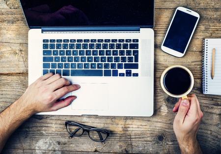Photo pour Desktop mix on a wooden office table background. View from above. - image libre de droit
