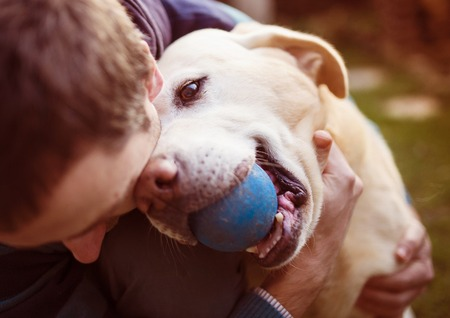 Photo pour Man having fun and playing with his dog - image libre de droit