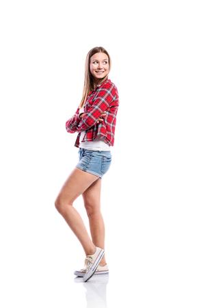 Standing Teenage Girl In Denim Shorts Tight Singlet Red