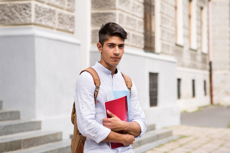 Photo pour Handsome teenage student in front of old building. - image libre de droit