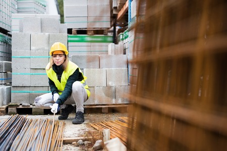 Photo for Young woman worker in an industrial area. - Royalty Free Image
