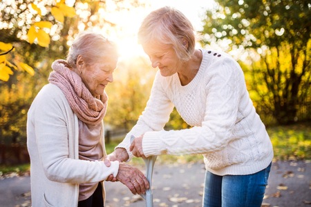 Foto de Senior women on a walk in autumn nature. - Imagen libre de derechos