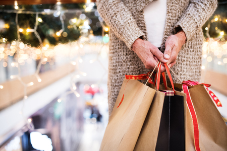 Photo pour Senior woman with bags doing Christmas shopping. - image libre de droit