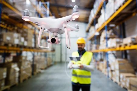 Photo pour Man with drone in a warehouse. - image libre de droit