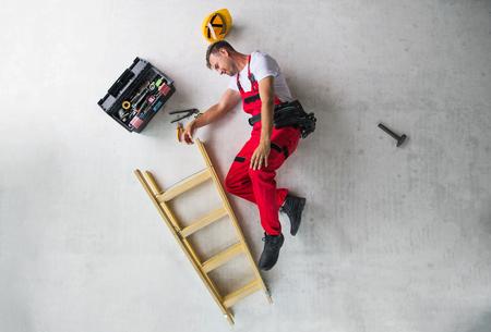 Photo pour An accident of a man worker at the construction site. Top view. - image libre de droit