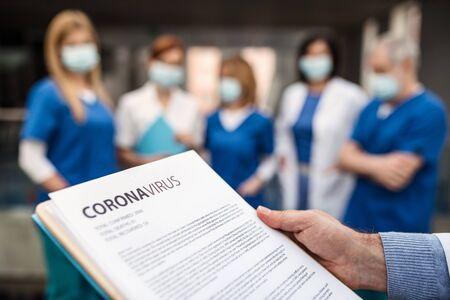Photo pour Group of doctors talking about corona virus on conference. - image libre de droit