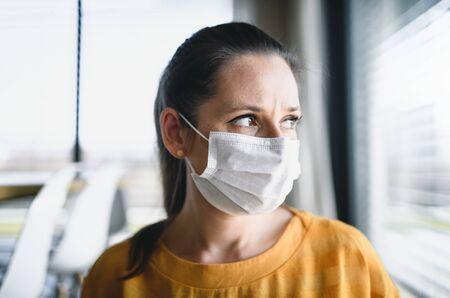 Photo pour Woman with face masks indoors at home, Corona virus and quarantine concept. - image libre de droit