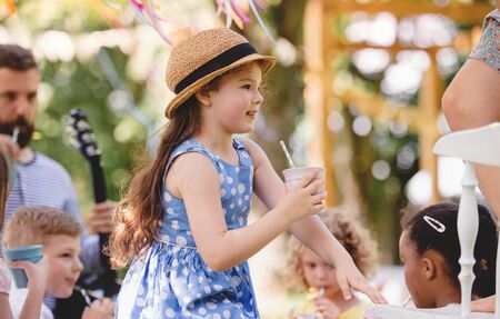 Photo for Small children on ground outdoors in garden in summer, playing. - Royalty Free Image