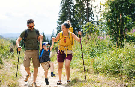Photo pour Family with small son hiking outdoors in summer nature. - image libre de droit