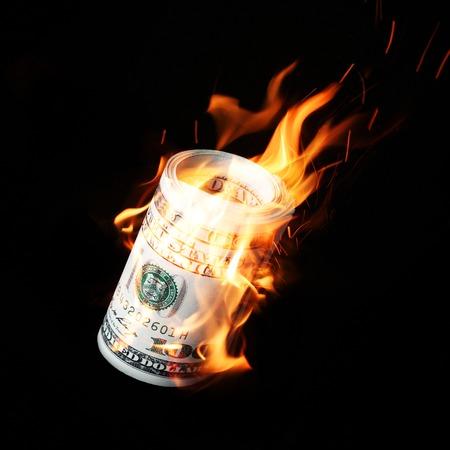 Photo for Burning one hundred dollar bills rolled black background - Royalty Free Image