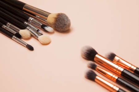 Photo for Various cosmetic brushes on pink background. Makeup brushes set for take care skin. - Royalty Free Image