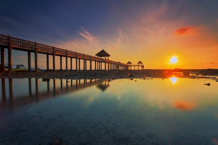 Photo for A long exposure picture of majestic sunrise with a jetty as a background at Tanjung Balau, Johore - Royalty Free Image