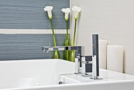 Part of modern bathroom in blue and gray tones with flowers