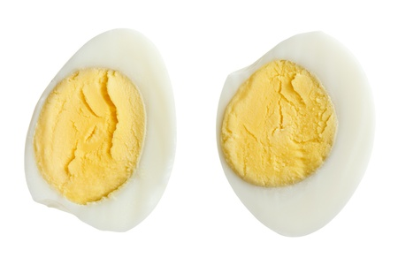 Two halves of boiled quail eggs, isolated on white