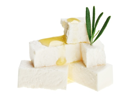 Feta cheese cubes with rosemary twig and oil drops, isolated on white