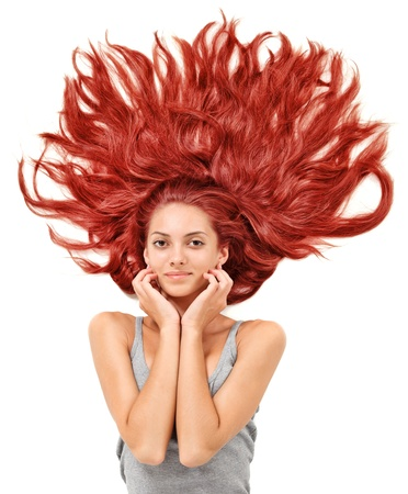 Young beautiful redhead woman with scattered long hairs on white