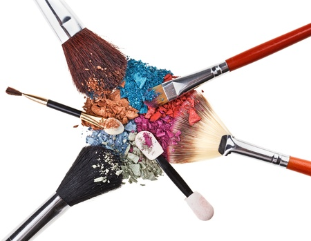 Composition with makeup brushes and broken multicolor eye shadowsの写真素材