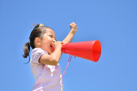 Girls cheer in the blue sky (megaphone)