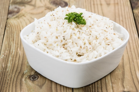 Fresh cooked Rice in a bowl on wooden background