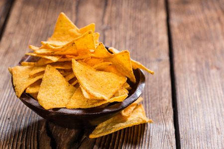 Portion of Nachos on rustic wooden background