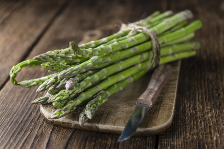 Green Asparagus (fresh harvested) on an old wooden table (selective focus)