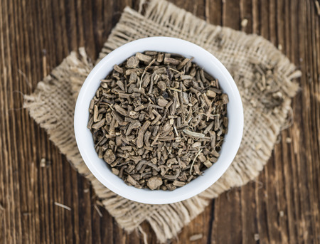 Foto für Dried Valerian roots (detailed close-up shot) on wooden background - Lizenzfreies Bild