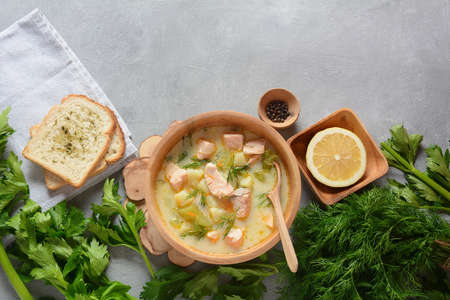 Photo for Creamy fish soup with salmon, potatoes, onions , carrots, dill and celery . Kalakeitto- traditional dish of the Finnish cuisine or Russian  Ukha Fish Head Soup. Healthy Food Concept. Omega -3 - Royalty Free Image