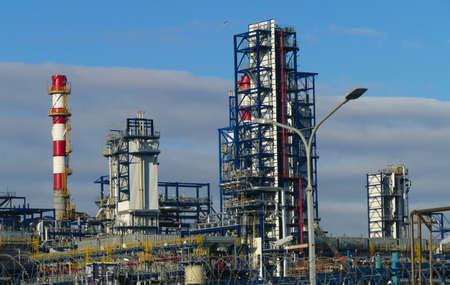 Foto für Corps of Moscow refinery in spring in clear weather - Lizenzfreies Bild