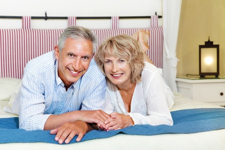 Happy mature couple at homeの写真素材