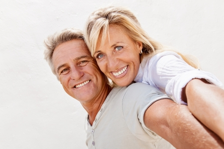 Mature couple smiling and embracingの写真素材