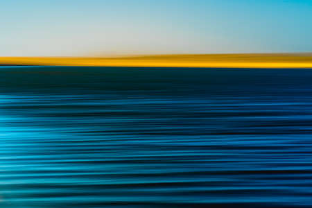Photo for Sand dunes and blue river abstract background. Motion blur, Creative line art in cyan, dark blue, turquoise, and yellow colors. - Royalty Free Image