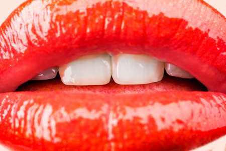 Photo pour Passion. Sensual female lips. White healthy teeth. Mouth with teeth smile. Red lipstick and sexy kiss. Lips close up. - image libre de droit
