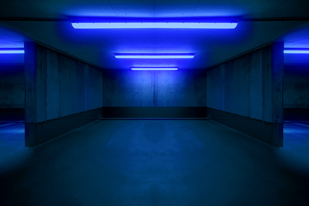Foto de illuminated parking lot / underground car parking spot - Imagen libre de derechos