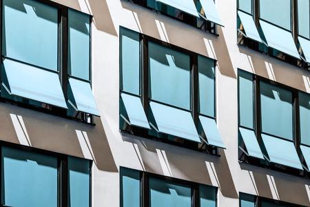 Photo pour closed  sun blinds on building facade , modern sunshades / awnings - image libre de droit