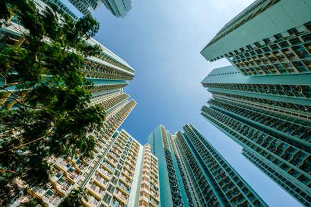 Photo pour looking up on high-rise apartment building, residential building facade, hongkong - image libre de droit