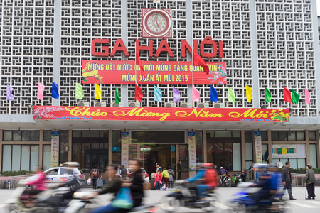 Hanoi, Vietnam - Feb 15, 2015: Front exterior view of Hanoi railways train station on Le Duan street, with banner Happy new year 2015