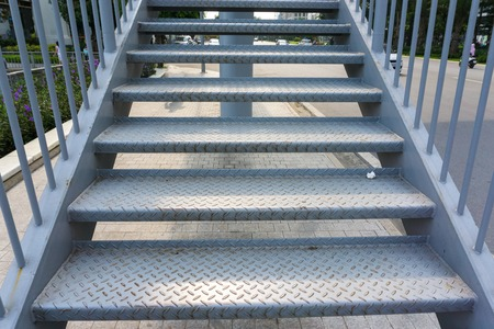 Photo pour Steel stair step to walk up or walk down to the outdoor public bridge - image libre de droit