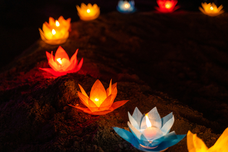 Photo for Colored lanterns and garlands at night on Vesak day for celebrating Buddha's birthday in Eastern culture, that made from paper and candle - Royalty Free Image