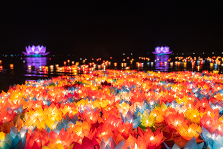 Photo for Floating colored lanterns and garlands on river at night on Vesak day for celebrating Buddha's birthday in Eastern culture, that made from paper and candle - Royalty Free Image