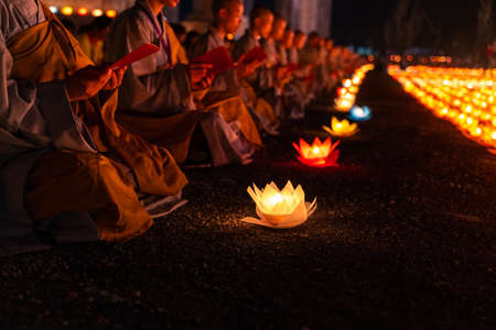 Photo for Monks praying at night on Vesak day for celebrating Buddha's birthday in Eastern culture - Royalty Free Image