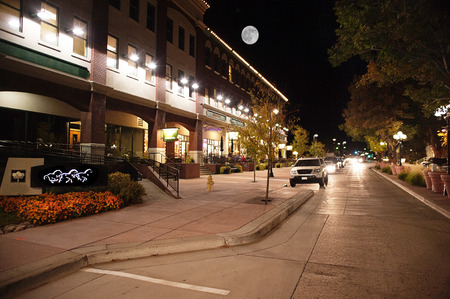 moonrise over main street in Parker, CO