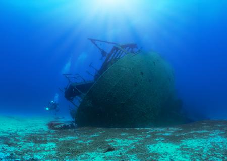Photo pour A sunken shipwreck in the mediterranean sea with a scuba diver, Greece - image libre de droit