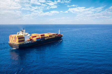Photo for Concept of global trade and shipping industry: aerial view of a container cargo ship traveling on the open sea - Royalty Free Image
