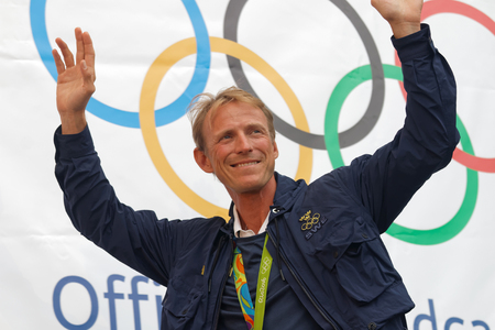 STOCKHOLM, SWEDEN - AUG 21, 2016: Smiling swedish show-jumper Peder Fredricson raising his arms when swedish olympic athletes are celebrated in Kungstradgarden, Stockholm,Sweden,August 21,2016