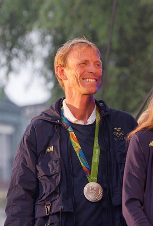 STOCKHOLM, SWEDEN - AUG 21, 2016: Smiling swedish show-jumper Peder Fredricson showing his medal when swedish olympic athletes are celebrated in Kungstradgarden, Stockholm,Sweden,August 21,2016