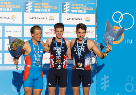 Contestant on the winner's stand in the Men's ITU World Triathlon series event in Stockholm, Sweden