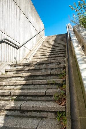 concrete steps leading up to a blue sky