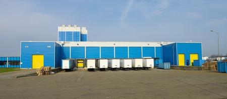 modern blue warehouse with loading docks