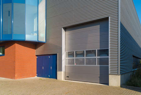 Photo for modern industrial unit with roller doors - Royalty Free Image